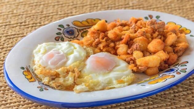 Huevos con migas y chorizo. Mesón de Fuencarral